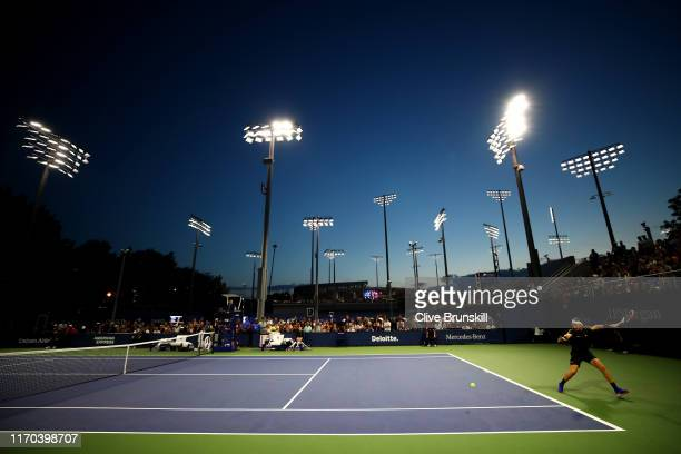 Cameron Norrie of Great Britain returns a shot during his men's singles first round match against Gregoire Barrere of France during day one of the...