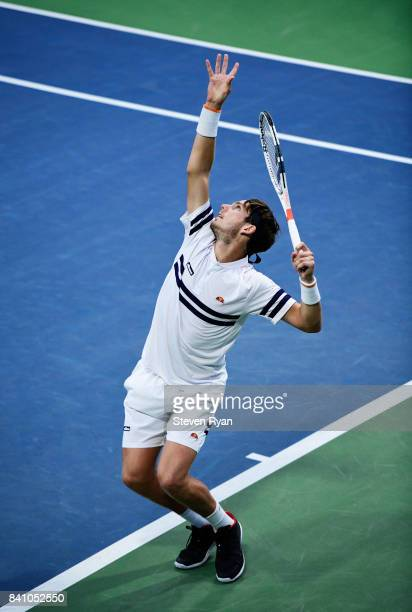 Cameron Norrie of Great Britain serves against Pablo Carreno Busta of Spain during their second round Men's Singles match on Day Three of the 2017 US...
