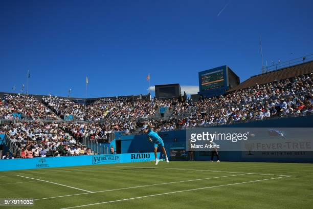 Cameron Norrie of Great Britain serves during his defeat to Stan Wawrinka of Switzerland on Day 1 of the FeverTree Championships at Queens Club on...