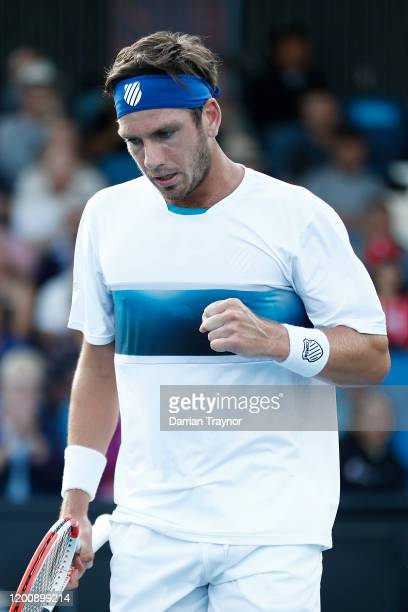 Cameron Norrie of Great Britain serves during his Men's Singles first round match against PierreHugues Herbert of France on day two of the 2020...