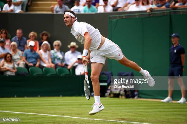 Cameron Norrie of Great Britain serves during the Gentlemen's Singles first round match against JoWilfried Tsonga of France on day one of the...