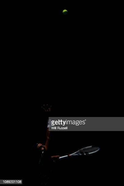 Cameron Norrie of Great Britain serves to Frances Tiafoe of the United States in the mens singles match during day six of the 2019 Hopman Cup at...