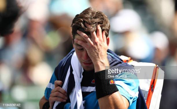 Cameron Norrie of Great Britain shows his frustration as he walks off court after his straight sets defeat 1against Felix AugerAliassime of Canada...