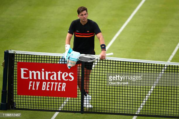 Cameron Norrie of Great Britain waits at the net for a video line challenge before swapping ends during his First Round Singles Match against Kevin...
