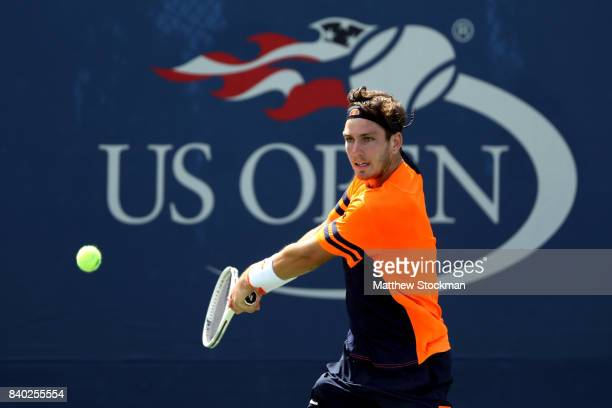 Cameron Norrie of the United Kingdom returns a shot during his first round Men's Singles match against Dmitry Tursunov of Russia on Day One of the...
