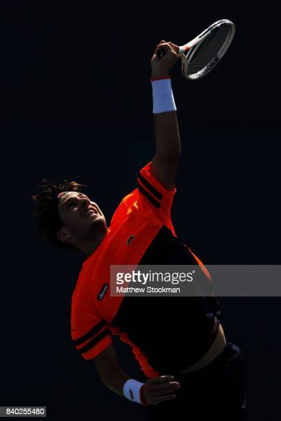 Cameron Norrie of the United Kingdom serves during his first round Men's Singles match against Dmitry Tursunov of Russia on Day One of the 2017 US...