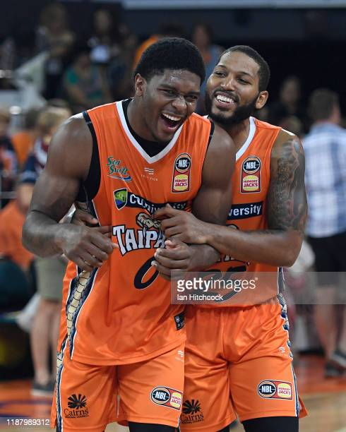 Cameron Oliver and DJ Newbill of the Taipans celebrate after winning the round 7 NBL match between the Cairns Taipans and the Brisbane Bullets on...