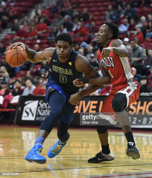 Cameron Oliver of the Nevada Wolf Pack drives against Kris Clyburn of the UNLV Rebels during their game at the Thomas Mack Center on February 25 2017...