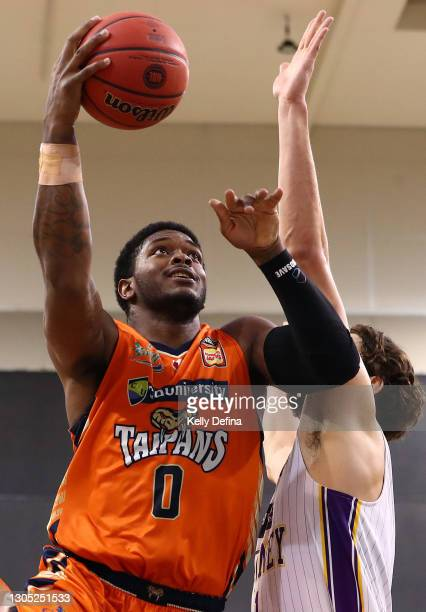Cameron Oliver of the Taipans drives to the basket during the NBL Cup match between the Cairns Taipans and the Sydney Kings at the State Basketball...