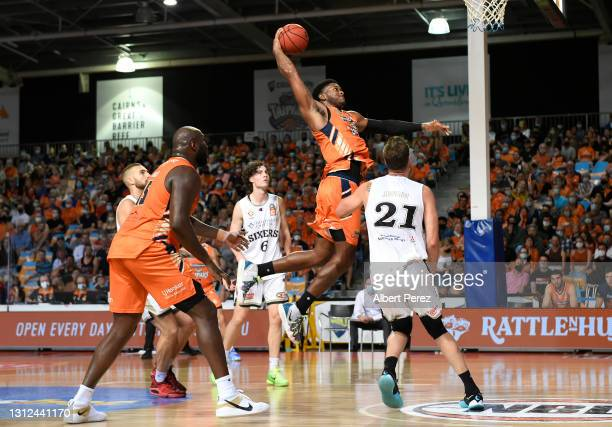Cameron Oliver of the Taipans gets up for a slam dunk during the round 14 NBL match between the Cairns Taipans and the Adelaide 36ers at Cairns Pop...
