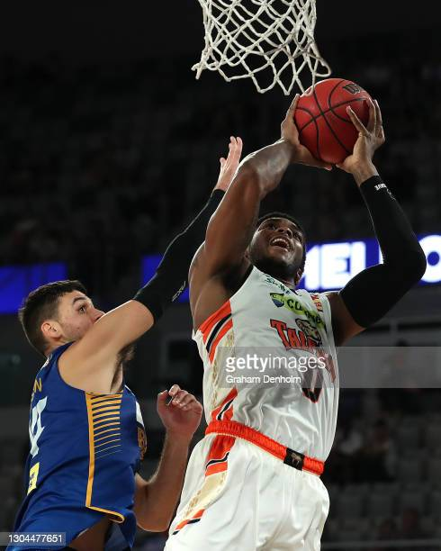 Cameron Oliver of the Taipans shoots under pressure during the NBL Cup match between the Brisbane Bullets and the Cairns Taipans at John Cain Arena...