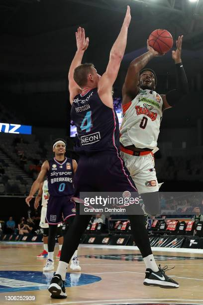 Cameron Oliver of the Taipans shoots under pressure during the NBL Cup match between the New Zealand Breakers and the Cairns Taipans at John Cain...