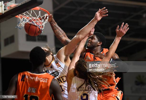 Cameron Oliver of the Taipans slam dunks the ball during the round two NBL match between the Cairns Taipans and the Sydney Kings at Cairns Pop Up...