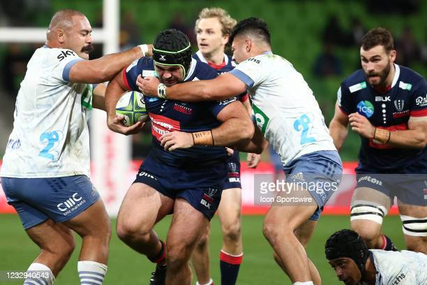 Cameron Orr of the Melbourne Rebels gets tackled during round one of the Super Rugby Trans Tasman match between the Melbourne Rebels and Blues at...