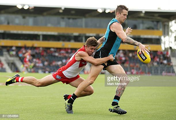 Cameron O'Shea of the Power is tackled by Jake Lloyd of the Swans during the 2016 NAB Challenge AFL match between the Sydney Swans and Port Adelaide...