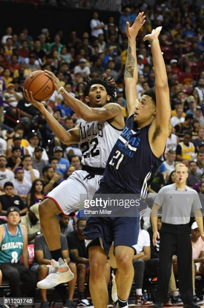 Cameron Payne of the Chicago Bulls drives to the basket against Brandon Ashley of the Dallas Mavericks during the 2017 Summer League at the Thomas...