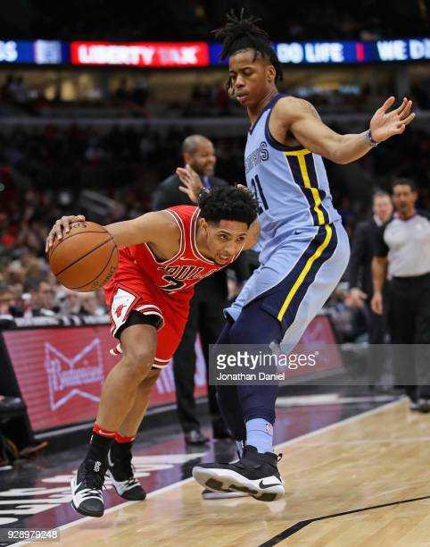 Cameron Payne of the Chicago Bulls steps out of bounds under pressure from Deyonta Davis of the Memphis Grizzlies at the United Center on March 7...