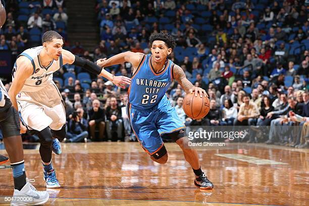 Cameron Payne of the Oklahoma City Thunder dribbles the ball against Zach LaVine of the Minnesota Timberwolves on January 12 2016 at Target Center in...