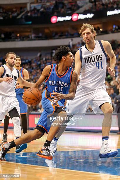 Cameron Payne of the Oklahoma City Thunder drives to the basket against the Dallas Mavericks on January 22 2016 at the American Airlines Center in...