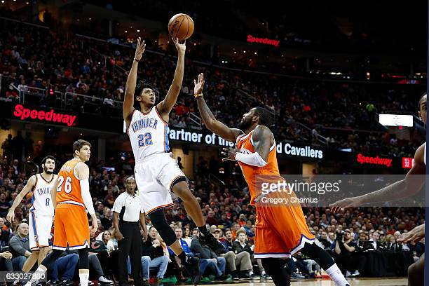 Cameron Payne of the Oklahoma City Thunder shoots over Kyrie Irving of the Cleveland Cavaliers during the first half at Quicken Loans Arena on...