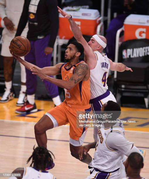 Cameron Payne of the Phoenix Suns drives to the basket past Alex Caruso of the Los Angeles Lakers in the first half of game four of the Western...