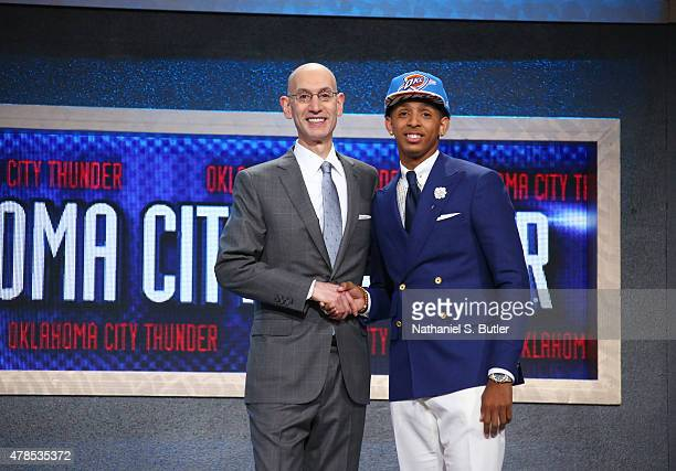 Cameron Payne shakes hands with NBA Commissioner Adam Silver after being selected number fourteen overall by the Oklahoma City Thunder during the...