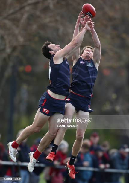 Cameron Pedersen of the Demons and Mitch Hannan of the Demons compete for the ball during a Melbourne Demons AFL training session at Gosch's Paddock...
