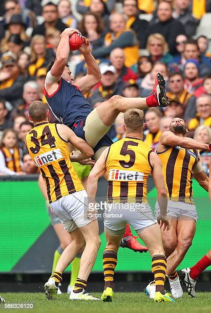Cameron Pedersen of the Demons takes a marks the ball during the round 20 AFL match between the Melbourne Demons and the Hawthorn Hawks at Melbourne...