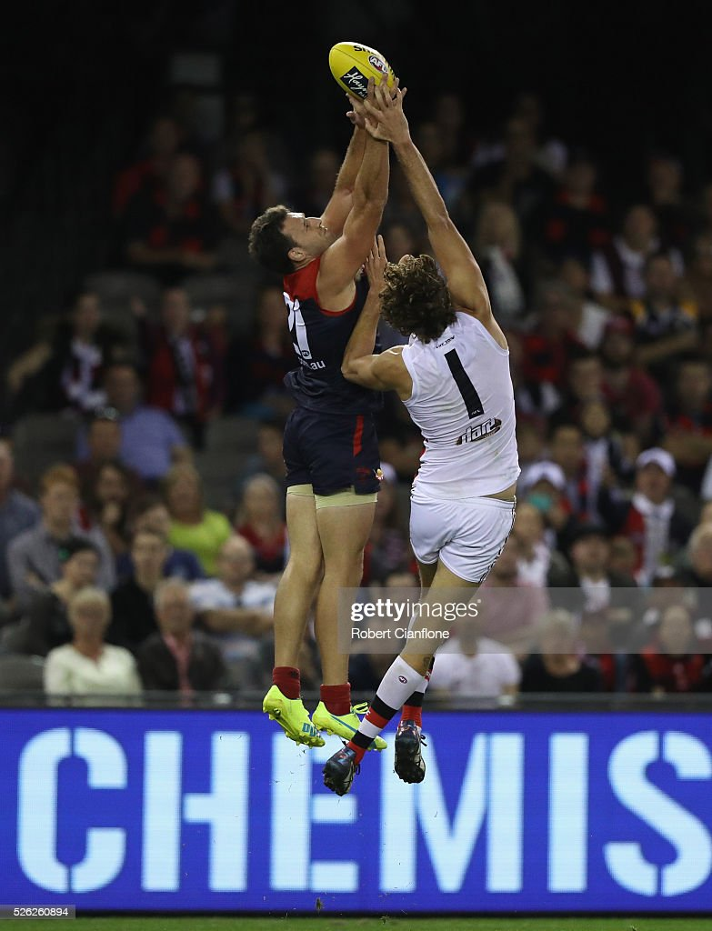 Cameron Pederson of the Demons is challenged by Tom Hickey of the Saints during the round six AFL match between the Melbourne Demons and the St Kilda Saints at Etihad Stadium on April 30, 2016 in Melbourne, Australia.
