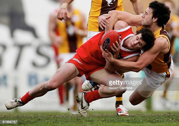 Cameron Pederson of the Hawks tackles Steven Browne of the Bullants during the round 14 VFL match between Northern Bullants and Box Hill Hawks at NAB...