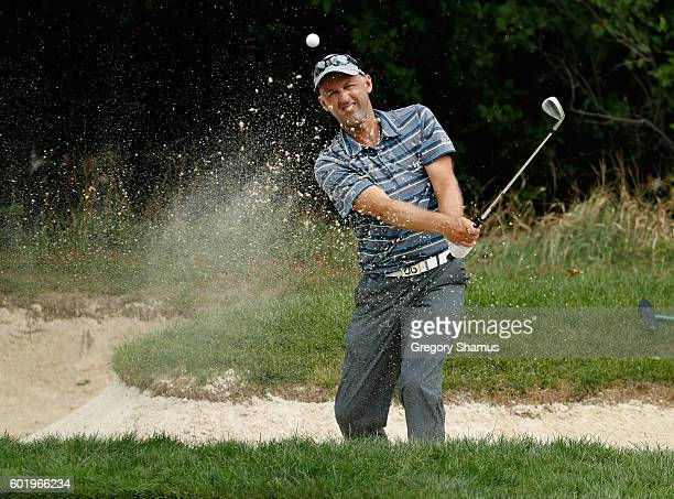 Cameron Percy of Australia hits from a green side sand trap on the 13th hole during the third round of the Webcom Tour 2016 DAP Championship at the...
