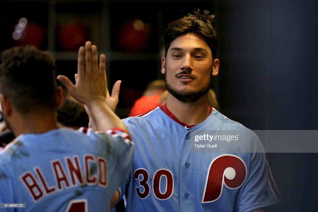 Cameron Perkins #30 of the Philadelphia Phillies celebrates with teammates after scoring a run in the fifth inning against the Milwaukee Brewers at Miller Park on July 14, 2017 in Milwaukee, Wisconsin.