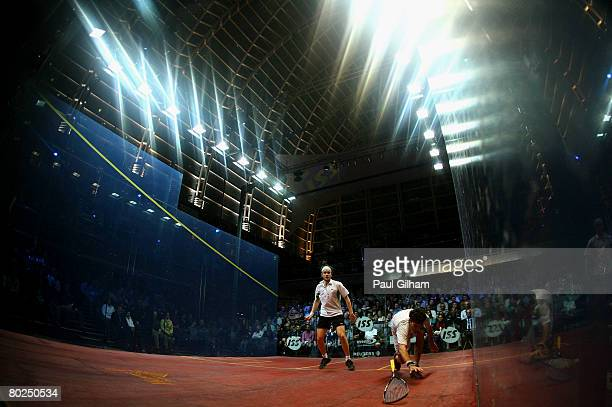 Cameron Pilley of Australia drops his racket during the match against James Willstrop of England during the final of the ISS Canary Wharf Squash...