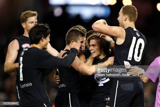Cameron Polson of the Blues celebrates his first AFL goal with LR Jack Silvagni Marc Murphy Jarrod Pickett and Harry McKay of the Blues during the...