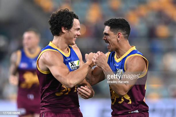 Cameron Rayner and Charlie Cameron of the Lions celebrate winning the round 15 AFL match between the Brisbane Lions and the Collingwood Magpies at...