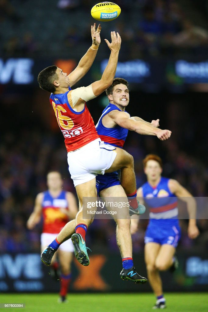 Cameron Rayner of the Lions (L) competes for the ball against Bailey Williams of the Bulldogs during the round eight AFL match between the Western Bulldogs and the Brisbane Lions at Etihad Stadium on May 12, 2018 in Melbourne, Australia.