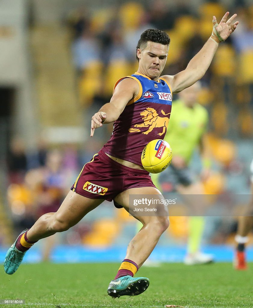 Cameron Rayner of the Lions kicks the ball during the round 14 AFL match between the Brisbane Lions and the Greater Western Sydney Giants at The Gabba on June 23, 2018 in Brisbane, Australia.