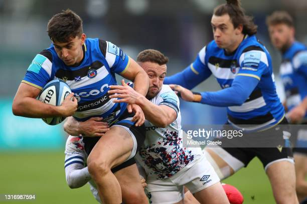 Cameron Redpath powers his way past the challenge of Andy Uren of Bristol during the Gallagher Premiership Rugby match between Bath and Bristol at...