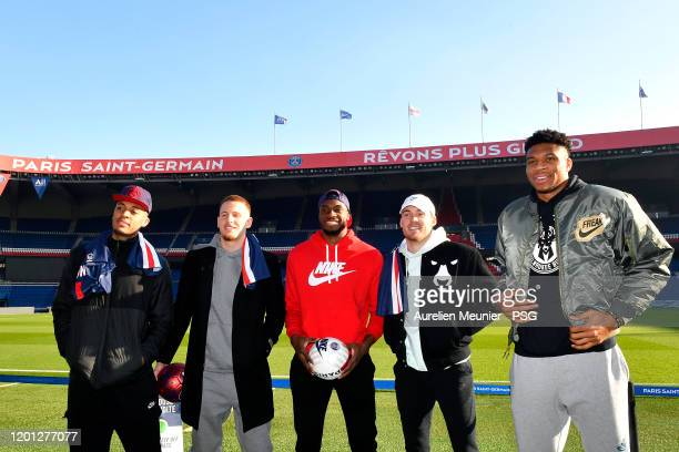 Cameron Reynolds, Donte Divincenzo, Thanasis Antetokounmpo, Pat Connaughton and Giannis Antetokounmpo of the Milwaukee Bucks pose in front of the...