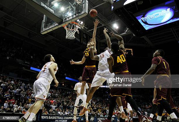Cameron Ridley of the Texas Longhorns shoots the game winning shot against the Arizona State Sun Devils during the second round of the 2014 NCAA...