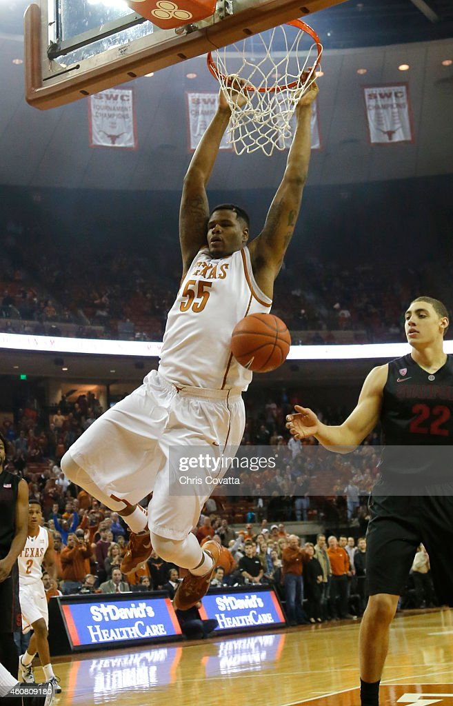 Cameron Ridley #55 of the Texas Longhorns slam dunks against the Stanford Cardinal at the Frank Erwin Center on December 23, 2014 in Austin, Texas.