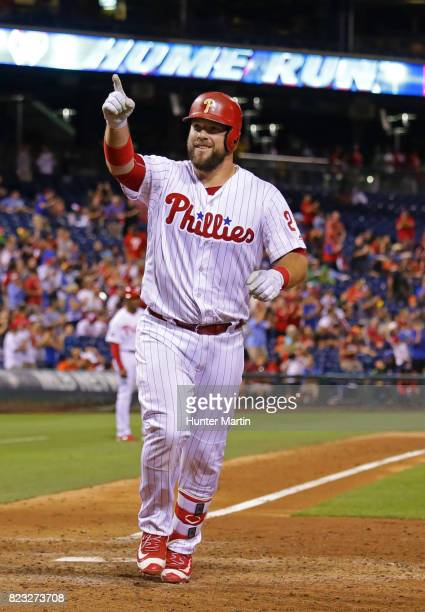 Cameron Rupp of the Philadelphia Phillies acknowledges the fans as he crosses home plate after hitting a tworun home run in the sixth inning during a...