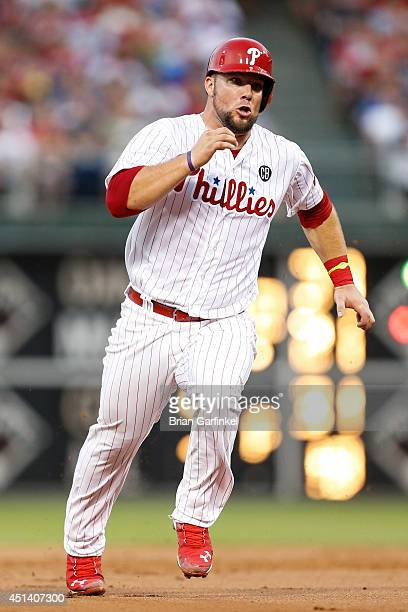 Cameron Rupp of the Philadelphia Phillies advances to third base on a Ben Revere singe in the third iinning of the second game of a doubleheader...