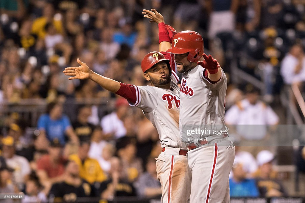 Cameron Rupp #29 of the Philadelphia Phillies celebrates with Andres Blanco #4 after hitting a two run home run in the ninth inning during the game against the Pittsburgh Pirates at PNC Park on July 22, 2016 in Pittsburgh, Pennsylvania.