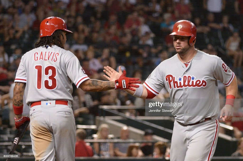 Cameron Rupp #29 of the Philadelphia Phillies celebrates with Freddy Galvis #13 after scoring against the Arizona Diamondbacks in the ninth inning of the MLB at Chase Field on June 23, 2017 in Phoenix, Arizona.