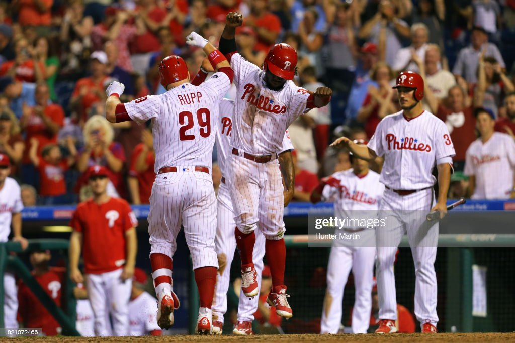 Cameron Rupp #29 of the Philadelphia Phillies celebrates with Odubel Herrera #37 at home plate after hitting a three-run home run in the eighth inning during a game against the Milwaukee Brewers at Citizens Bank Park on July 22, 2017 in Philadelphia, Pennsylvania. The Brewers won 9-8.
