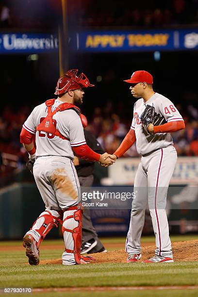 Cameron Rupp of the Philadelphia Phillies congratulates Jeanmar Gomez after a win over the St Louis Cardinals 10 at Busch Stadium on May 3 2016 in St...