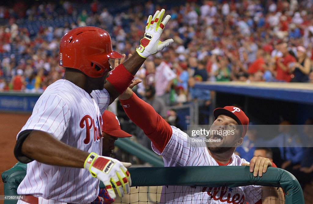 Cameron Rupp #29 of the Philadelphia Phillies congratulates teammate Ryan Howard #6 after a home run in the fourth inning against the New York Mets at Citizens Bank Park on May 8, 2015 in Philadelphia, Pennsylvania.
