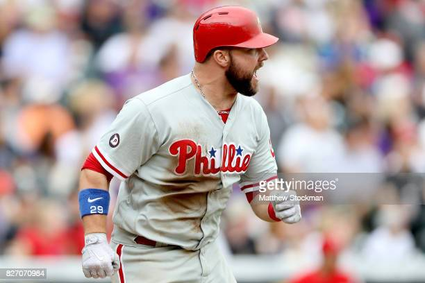 Cameron Rupp of the Philadelphia Phillies hits a 2 RBI double in the ninth inning against the Colorado Rockies at Coors Field on August 6 2017 in...
