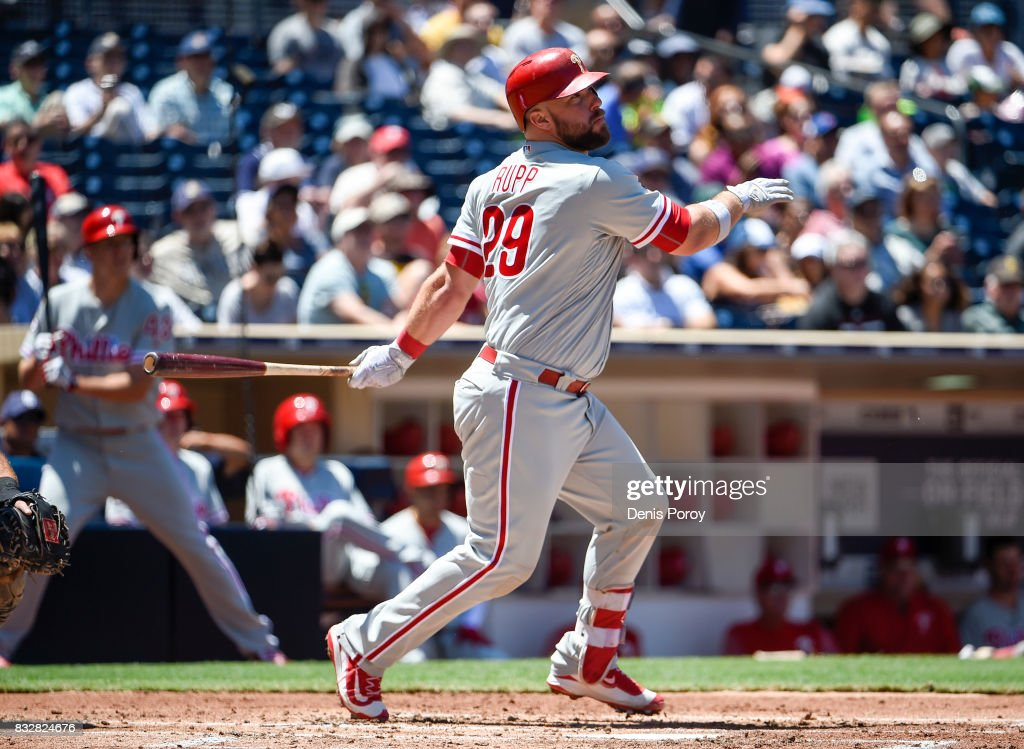 Cameron Rupp #29 of the Philadelphia Phillies hits a double during the third inning of a baseball game against the San Diego Padres at PETCO Park on August 16, 2017 in San Diego, California.